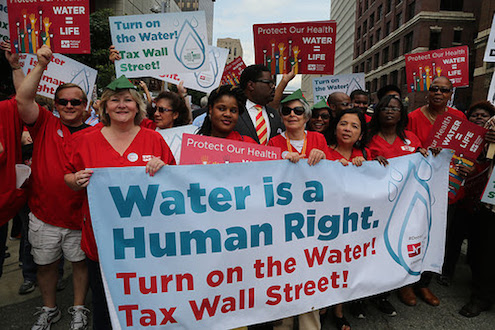 RNs lead the march demanding that the Detroit Water and Sewage Dept. turn back on the water to its residents.