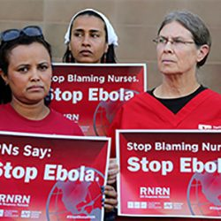three women in red holding signs that say 'Stop Ebola'
