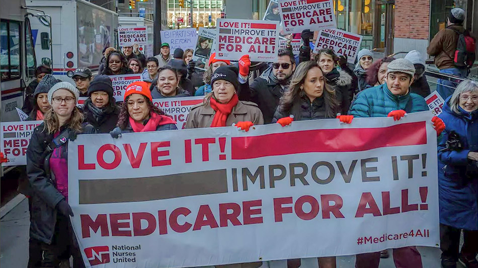 Supporters of single-payer healthcare march to the state Capitol on April 26 in Sacramento. (Rich Pedroncelli / Associated Press)